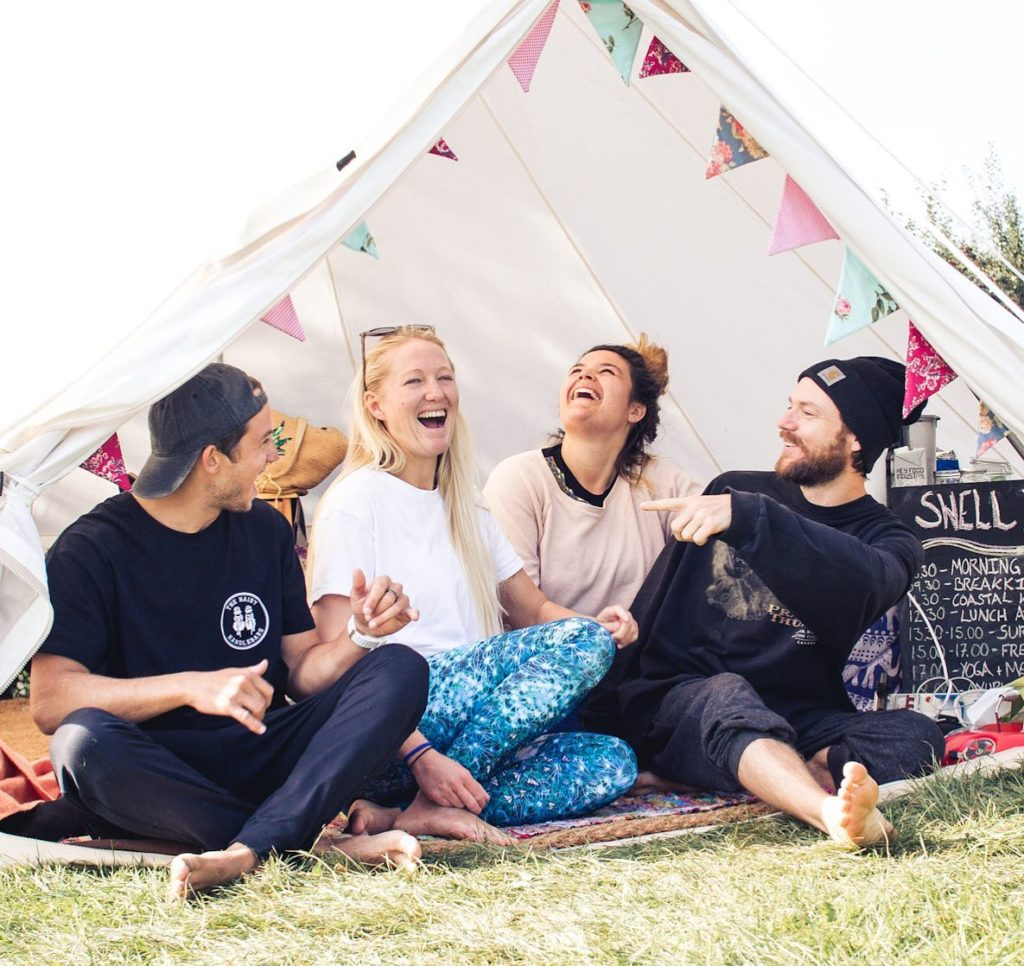 Swell Yoga Retreat North Devon - team laughing in tent