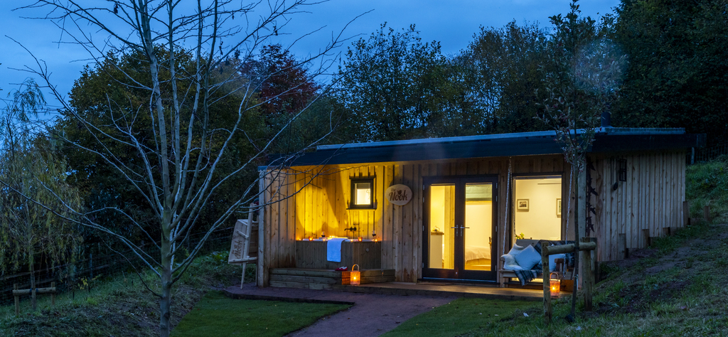 Forest of Dean Cabins at The Roost Glamping: the exterior at night