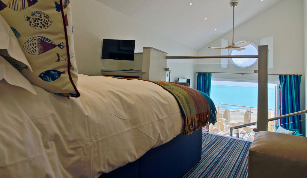 beachcroft beach huts - bedroom with view