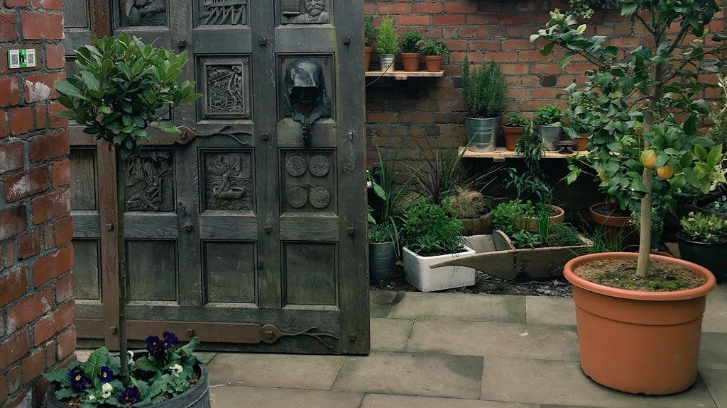 secret garden cafe in cardiff - wooden door
