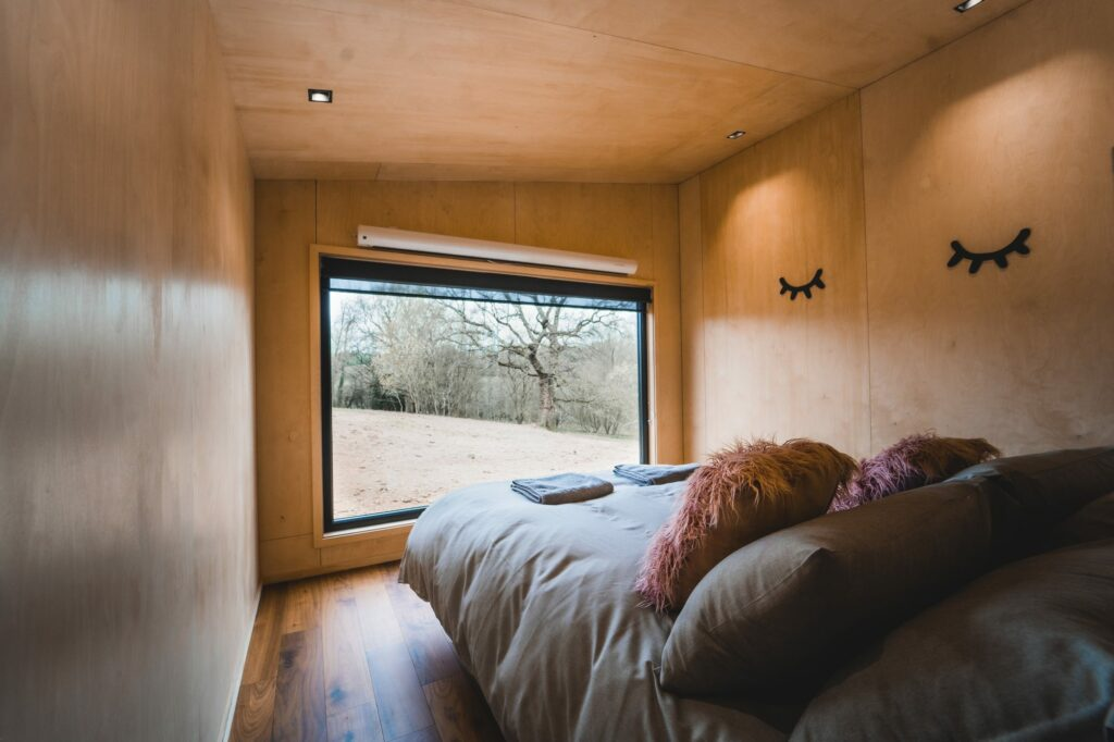 Hidey-Hole-Glamping-East-Sussex bed facing picture window