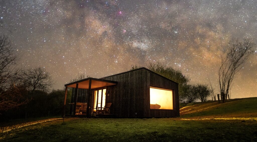 Hidey-hole cabin east sussex glamping experience - outside view at night
