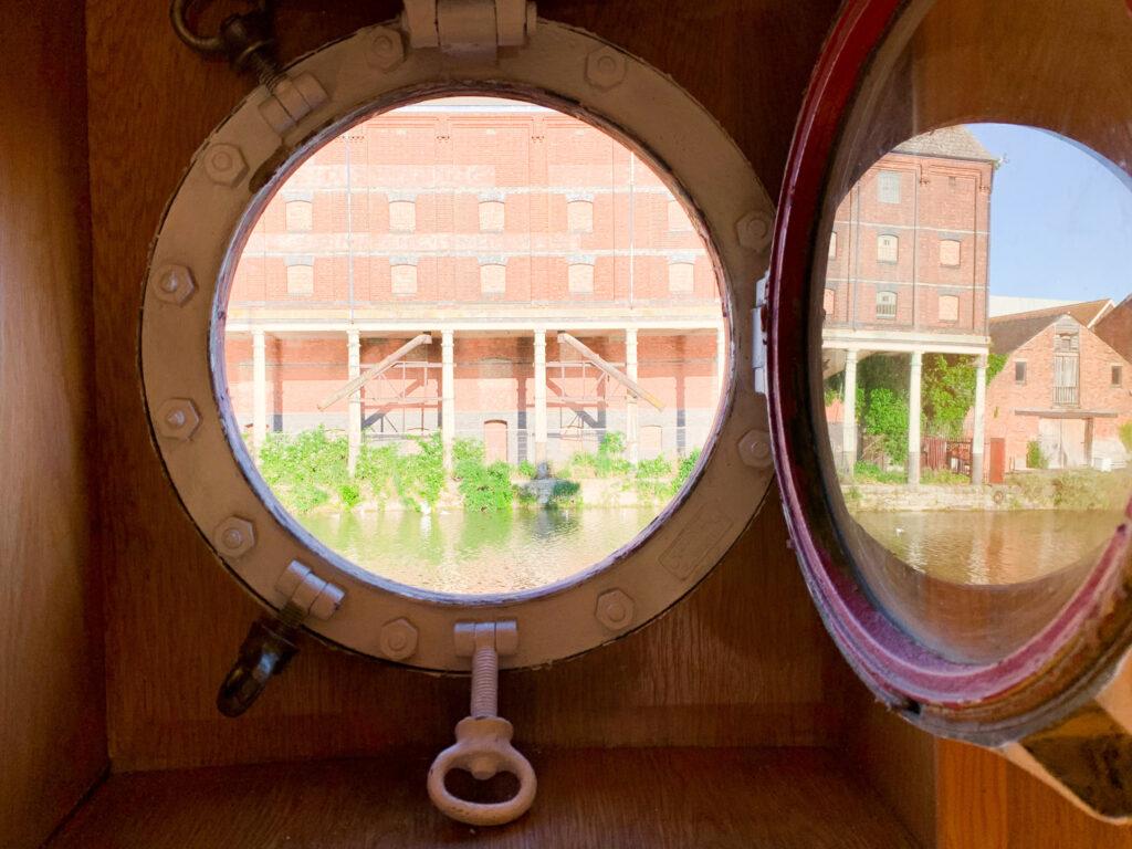 SULA-Lightship-Gloucester-Docks water through porthole