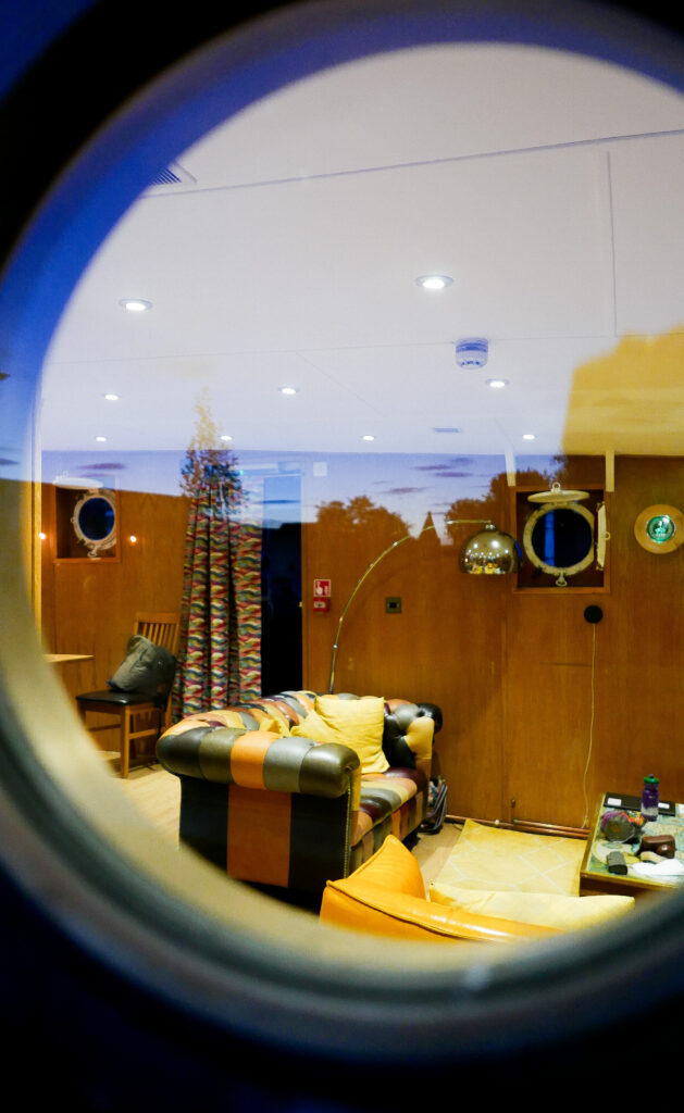 SULA-Lightship-Gloucester-Docks living space through porthole