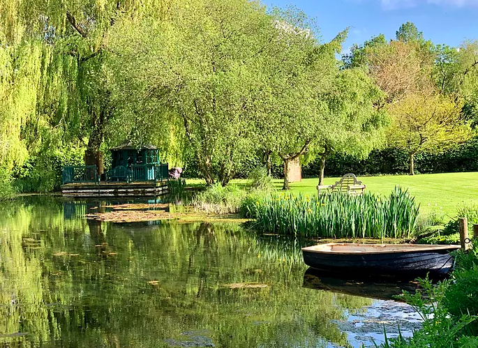 The Meadow Glamping in Hampshire - lake and boat