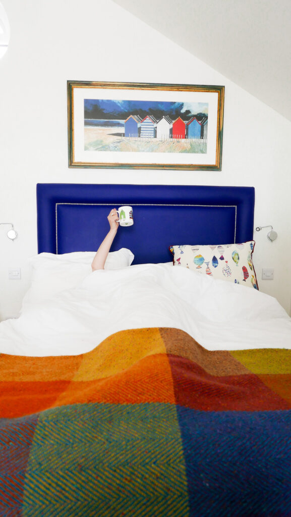 beachcroft-beach-huts: bedroom and cup