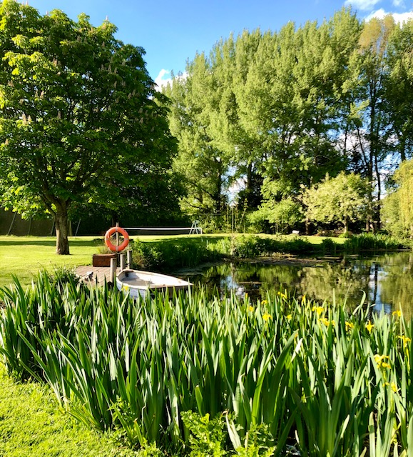The Meadow Glamping in Hampshire - lake and rowing boat