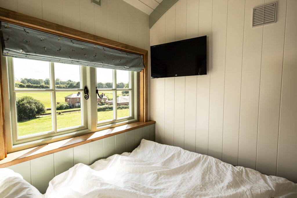ewe-glamping-northamptonshire - bedroom in shepherd's hut